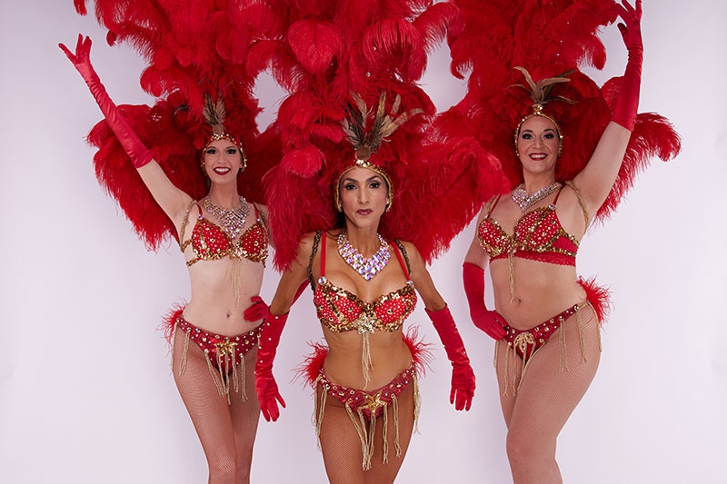Members of BurlesQ cast in Red Feather Costumes